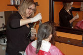 Female hair coloring at a salon — Stock Photo