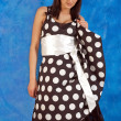 Girl in polka-dot dress — Stock Photo