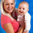 Mother smile to her child — Stock Photo