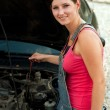 Stock Photo: Womwith her broken down car