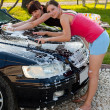 Stock Photo: Womwashing car