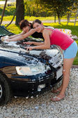 Woman washing car — Stock Photo