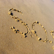 S.O.S. on sand — Stock Photo #2700243