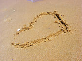 Heart in the sand — Stock fotografie