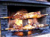 Roast lamb by fire — Stock Photo