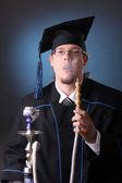 Young graduation man — Stock Photo