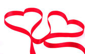 Two hearts from red ribbon — Stock Photo