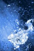 Splash in einem glas. — Stockfoto