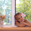 A girl in the window. - Stockfoto