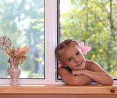 A girl in the window. — Stockfoto