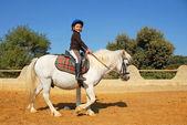 Child and pony — Stock Photo