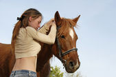 Teen and horse — Stock Photo