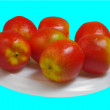 Red small apples are on white plate — Stock Photo