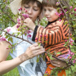 Royalty-Free Stock Photo: Mum and the daughter with a branch in hands