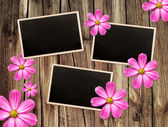 Vintage photo frames over wood background — Stock Photo