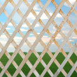 Wooden trellis over summer landscape background — Stock Photo
