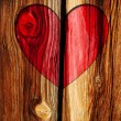 Stock Photo: Red heart on wooden brown wall background