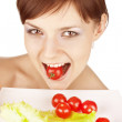 Girl with red tomatoes — Stock Photo