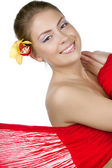 Beautiful girl with a yellow orchid — Stockfoto