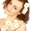 Beautiful woman with camomile flower — Stock Photo