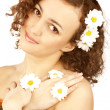 Beautiful woman with camomile flower - Stock Photo