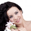 Women with a lily flower — Stock Photo #2969958