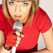 Beautiful girl with microphone — Stock Photo #3033548