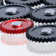 Steel gears in connection with red one — Stock Photo #2714320