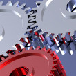 Steel gears in connection with red one — Stock Photo