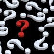 Stock Photo: White question marks with red one.