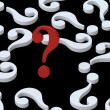 Royalty-Free Stock Photo: White question marks with red one.