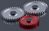 Steel gears in connection with red one. — Stock Photo