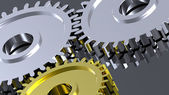 Steel gears in connection with gold one. — Stock Photo