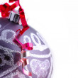Christmas ball with red ribbon - Stok fotoğraf