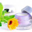 Stock Photo: Closeup of jar of moisturizing face cream and fresh nasturtium f