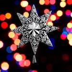 Decorative christmas star - on christmas lichts background.. — Stock Photo