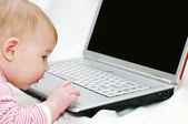 Baby working on Laptop — Stock Photo