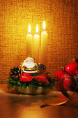 Santa in candles light and christmas ball — Stock Photo