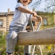 Little boy on a playground. - Stock Photo