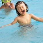 Little boy in pool. — Stock Photo