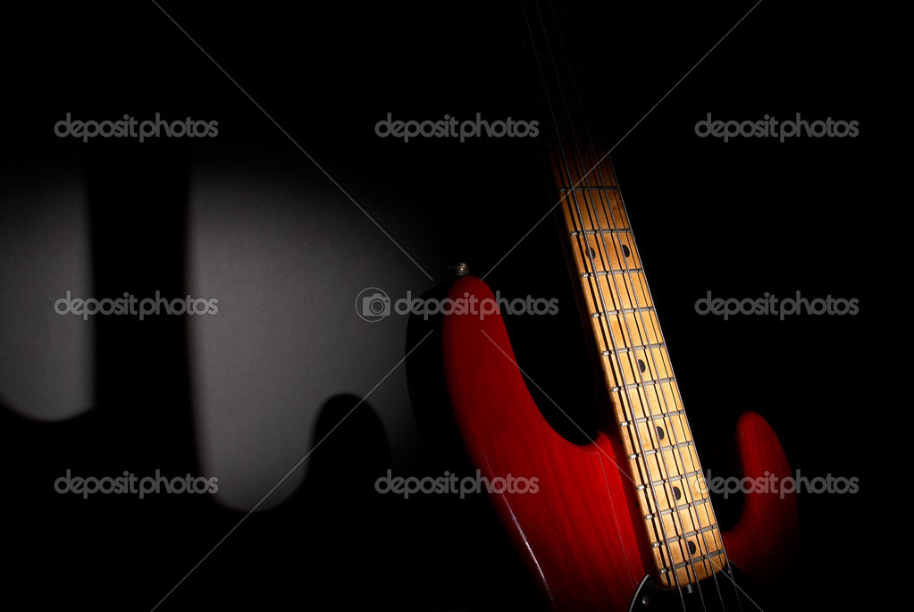 Wooden four string fretted  electric bass instrument  Stock Photo #3166780