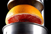 Fresh grapefruit about to be juiced for breakfast — Stock Photo