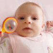 Baby girl holding rattle - Foto Stock