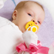 Stock Photo: Baby girl with pink ribbon
