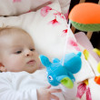 Baby playing with toys - Stok fotoğraf
