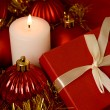 Red gift box and candle - Foto Stock