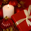 Red gift box and candle — Stock Photo