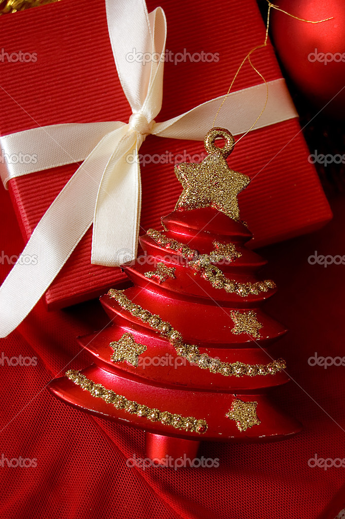 Red gift box and Christmas tree toy — Stock Photo #3678924