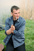Handsome man with a cigarette — Stock Photo