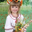 Stock Photo: Cute girl in national dress and wreath